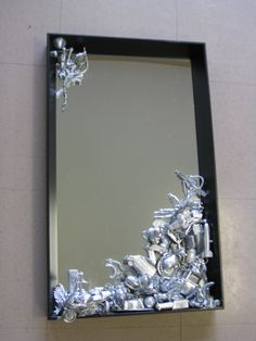 Repurposed toys make a great accent to this mirror.  My kids have tons of games with only half the pieces!