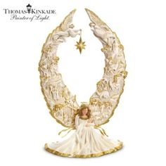Hear a classic recording by Thomas Kinkade with this glowing angel sculpture.