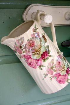Vintage pitcher. First, I need a pegged holder thing like this by the back door that leads to the coop. Second, I so need to find some prettier containers like this to bring out their daily feed and water from the back porch. Small touches make me happy :D