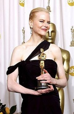 "Nicole Kidman wins an Oscar for Best Actress 2003 for ""The Hours"""