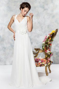 Silky crepe chiffon bridal gown with straps and keyhole back. Decorated with a shimmering ribbon