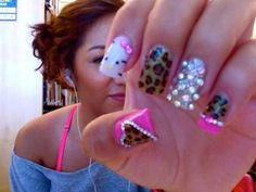 Hello kitty leopard print nails with bling