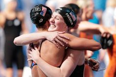 Megan Romano and Missy Franklin (R) of the USA celebrate after the Swimming Women's4x100mFreestyle on day nine of the 15th FINA World Championships at Palau Sant Jordi on July 28, 2013 in Barcelona, Spain.