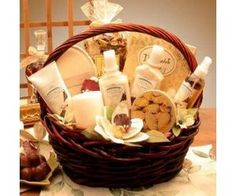 Spa Gift Basket - Spa Gift Basket - loofah, towel, scrubbing brush, body scrub, bubble bath, shower gel, eye mask, scented candles, body moistursier, soap, room spray, magazine, tea and a cute mug, book of Zen, CD of relaxing music, bath pillow, bottle of wine, shampoo, conditioner, nail polish, toe separators, nail file, chocolate, face mask, candies, matches, room spray