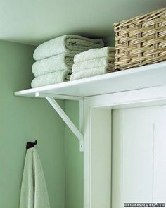 Brilliant small space storage idea. Use vertical space above the door for towels and bathroom storage.