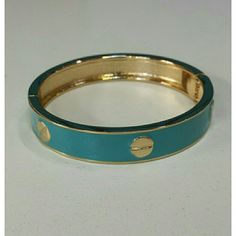 """Gold & Turquoise hinged screw bangle NWT Gorgeous gold tone and turquoise screw bangle. Hinged. Fits wrist up to 7.5"""". 2-1/2"""" diameter. Brand new with tag. Great quality and design. Tarnish free metal. Jill Marie Boutique Jewelry Bracelets"""