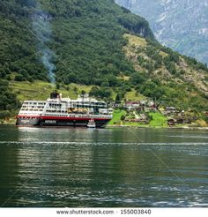 GEIRANGER, NORWAY: Cruise ship Hurtigruten came into Geiranger port, Norway. Geiranger fjord was included by UNESCO in the list of the world natural heritage.