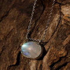 Moonstone oval pendant necklace in silver prong and bezel setting with fine heavily oxidized silver chain
