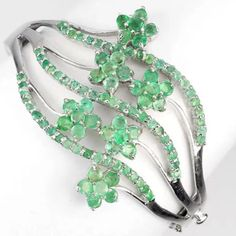 HPNWOT Real Brazil Emerald 925 Silver Bangle HOST PICK 11/22 for the Wardrobe Staples Party!   NWOT Real Natural Brazil Emerald 14K White Gold Coating 925 Silver Flower Bangle. 157.61 CT (total weight of silver and stones). Stones 2.5 to 3.0mm. Length 2.2 x 2.1 inches. Face of the bracelet is 66.0 x 48.0mm. Stone shape is round facet. Color of emerald is top rich green. Stone clarity is transparent. No Trading and No PayPal Jewelry