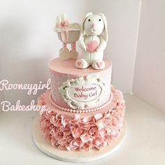 Bunny/Rabbit and baby stroller/carriage baby shower cake; cake lace, ruffles, vintage, pink