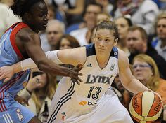 Lindsay Whalen of the Minnesota Lynx handles the basketball against an opposing player from the visiting Atlanta Dream in the 2013 WNBA FINALS GAME ONE vs. Atlanta Dream