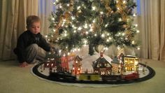 Love the idea of setting up a little village with a train under the Christmas tree!