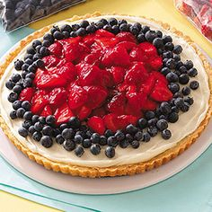 Patriotic Fruit Pizza Recipe -When strawberry season arrives, folks who know me anticipate this flavorful fruity dessert. It's very pretty and always gets lots of compliments whenever I take it.                               —Amy Murdoch, Union Grove, Wisconsin