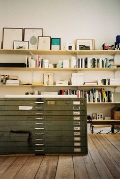 Metal flat files serve as a secondary surface — DIY plywood office shelving for home office studio