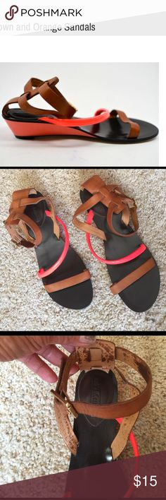 Juicy Couture Sandals Cute and sassy brown and orange sandals from Juicy Couture🔸there's a stain inside one of the strap but if you're wearing it will. It show🔸size 81/2 Juicy Couture Shoes Sandals