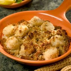Awesome Baked Sea Scallops Allrecipes.com, butter, garlic, shallots, nutmeg, bread crumbs