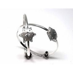 Pendientes de plata de primera ley de aro con una estrella tallada en mate. REF:110263470200. PRECIO:48,40€