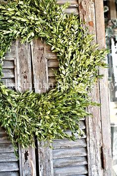 Dried floral decor on rustic weathered shutters....