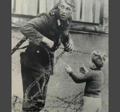 This is a photograph of an East German soldier helping a little boy cross the newly erected Berlin Wall the day it was built, August 13, 1961. Photo credit: Does anyone know who took this image? Margaret Hamilton, West Berlin, Berlin Wall, Hidden Photos, History Teachers, Science Books, Historical Pictures, The Funny, Little Boys
