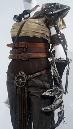 The Mad Max: Fury Road costumes currently on exhibit at FIDM in Los Angeles, including Max, Imperator Furiosa, and Cheedo the Fragile.