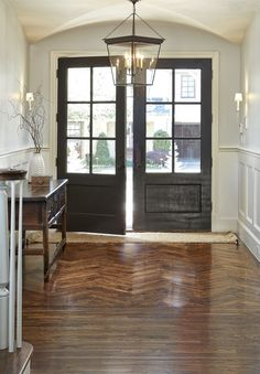 Double front door with paneled windows and gorgeous hardwood floors | Evensen Design Black Front Doors, Double Front Doors, Grey Wall Color, Color Black, Simple Elegance, Elegant, Foyer Decorating, Decorating Ideas, Interior Design Boards