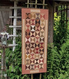 """This scrappy """"Hour by Hour"""" table runner is made of easy Hourglass blocks."""