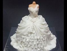 A Victorian gown cake. The dress part is cake covered in layers n layers of fondant...