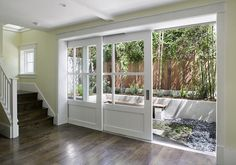 Sliding glass doors with wood frames.