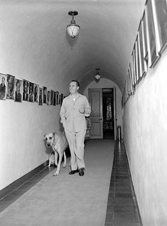 Harold Lloyd and his dog at his Estate in Beverly Hills.