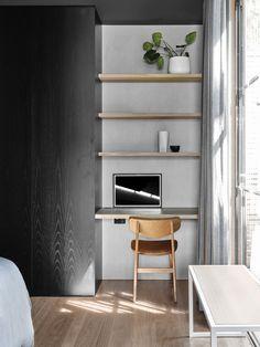 concrete wall blue carpet grey sofa eames lounge chair black wall moody living room Rob Kennon Architects   Burnley House