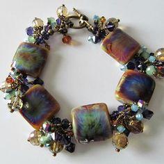 Beaded jewelry and lampwork jewelry designs - pacificjewelrydesigns.com - Tie dye lampwork and crystal beaded bracelet