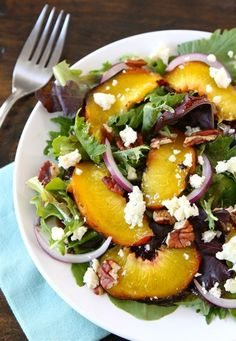 Grilled Peach Salad with blue cheese, walnuts, red onion, and balsamic dressing! Perfect sweet and summery salad!