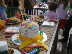 Cover a cake with plain white fondant and give the kids edible markers to decorate it. So much fun!