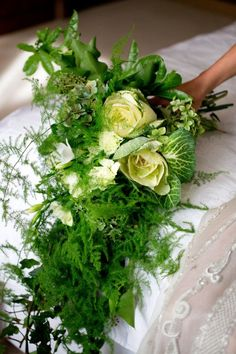 A wintry bouquet of ferns and cabbage leaves designed by Cecilia Fox
