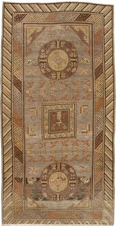 A Samarkand rug BB4394 - An early 20th century Samarkand rug, the abrashed gray field with geometric vines and leaves around a pair of light ...