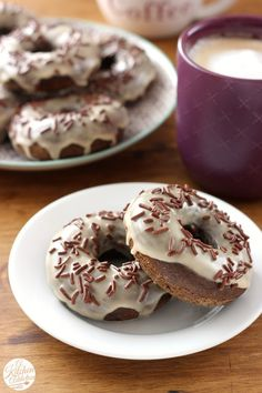Mocha Chip Donuts recipe from @akitchenaddict - The donut itself has coffee, cocoa powder, and chocolate chips in it while the glaze is made with more coffee and the sprinkles are chocolate! Perfect for enjoying with your favorite coffee drink! #doughnuts #baking