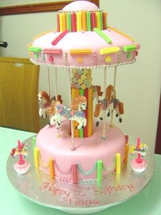 Merry Go Round Cake - The cake that started it all - this was my first cake ever - the recipient my daughter, easy customer, she was only two at the time and was not equipped to complain!!  Everything is edible except the sticks through the horses.  The horses I drew first, then flooded them and then painted them.  Thanks for browsing :)