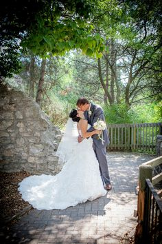 Textured dress, White and yellow bouquet, grey suit, stone wall, forest background, Cambridge Mill, Cambridge, Ontario, Canada wedding photography experts | Anne Edgar Photography