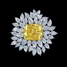 Graff Diamond brooch with an intense yellow diamond center