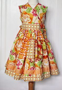 OMG!! If I have a little girl someday, I WILL make this dress for her....