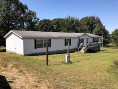 PRICE BLOCKBUSTER! Only $99,900 for this super 3 bedroom, 2.5 bath with 20 ac m/l, big horse/hay etc. barn (30x50), 1 car detached garage, Old farm house/shed, nice size pond, fenced on 3 sides. What a deal! Inside house is move in ready (need to stretch carpet) but other than carpet it's full of light from the big windows and very nice. Hunt or ride your 4wheeler on the property that is only 8.5 miles from Buffalo in Long Lane MO