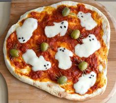 Mozzarella ghosts and olive spiders make for a Halloween themed pizza