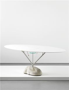 ANDREA BRANZI 'Flying' table, 2006  Painted wood, tubular aluminium, glass, steel cable, concrete. 69.4 x 194.5 x 106 cm (27 3/8 x 76 5/8 x 41 3/4 in) From the edition of 12. Edited by Design Gallery Milan, Italy.