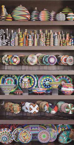 David Arment's large collection of Zulu telephone wire art in zig zag patterns displayed together in a group via Atticmag.com (Artisans create telephone wire art by covering baskets, bottles and more with colorful plastic-coated copper wire.)