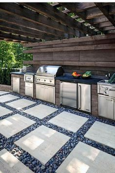 Looking for a an outdoor kitchen idea? For this landscape project, the Borealis wall was used for the back wall and the island, which includes an outdoor grill, a small fridge and other home appliances made for outdoor living. The Travertina Raw slabs wer Backyard Kitchen, Outdoor Kitchen Design, Backyard Patio, Kitchen Decor, Simple Outdoor Kitchen, Sloped Backyard, Backyard Landscaping, Modular Outdoor Kitchens, Concrete Backyard