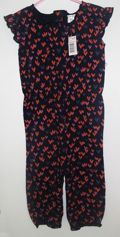 - F&F navy short sleeve and pants romper with orange, pink and grey hearts - size 12-18 months - brand new with tags - 100 % cotton - 20 NIS www.clothingcloset.co.il