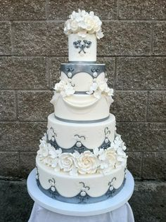 Elegant Ivory & Grey Wedding Cake with Roses, Draping & Jewel Accents
