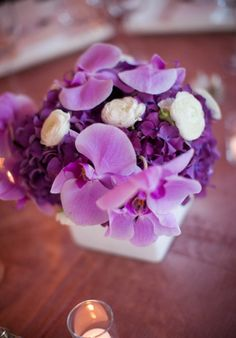 Here is a centerpieces with hydrangea like yours - where the white ranunculus is here your would be white freesia and where the pink phaleanopsis orchids are - yours would be green cymbidium orchids