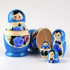 "This blue five piece nesting doll was handmade in Russia, the traditional matryoshka-making way, by skilled artisans. This doll is about 6 3/4"" tall, has been gloss finished, and would look great with a blue decor theme! A touch of purple can be seen on the biggest doll"