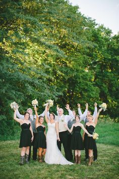 The bridesmaids wore short, black sweet heart neckline dresses and cowboy boots while the groomsmen were casual in black Wrangler jeans, white button ups, and vests